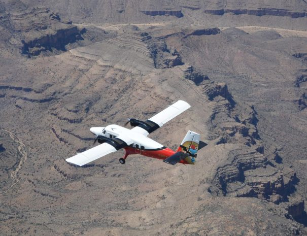 plane-flying-over-grand-canyon-brown-background
